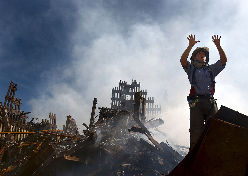A fireman calls for 10 more rescue workers to help at the WTC, 15 Sept 2001