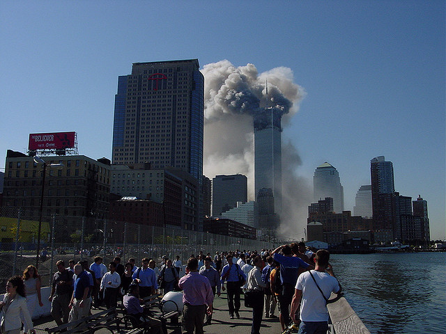 The north tower of the world trade center billows with smoke