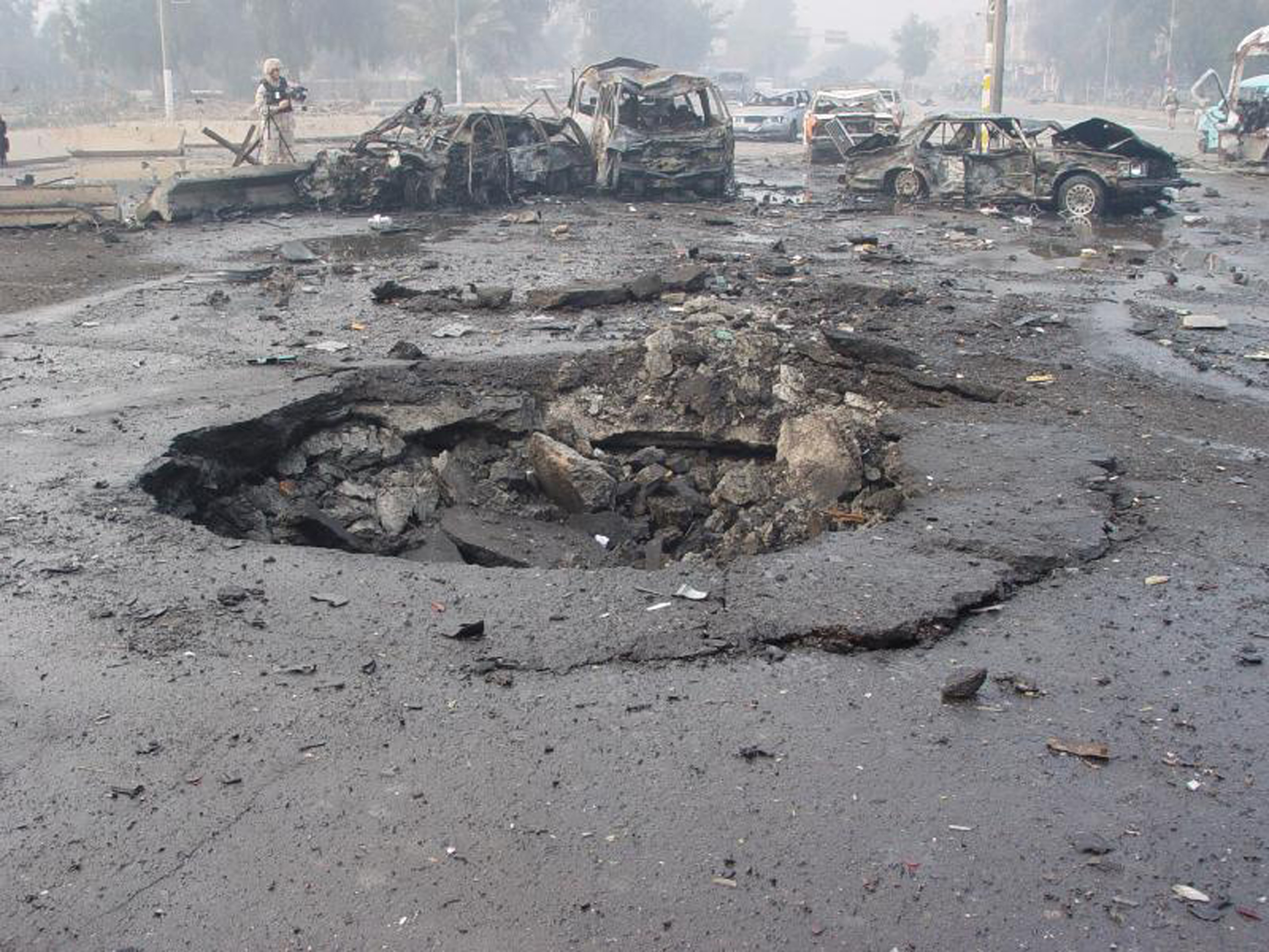 A suicide car bomb crater in Iraq, 2007