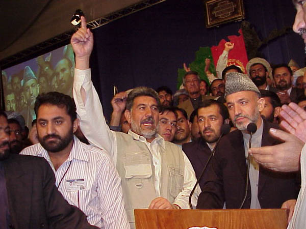 Chairman Hamid Karzai surrounded by supporters after his victory in balloting at the Loya Jirga, or Grand Council