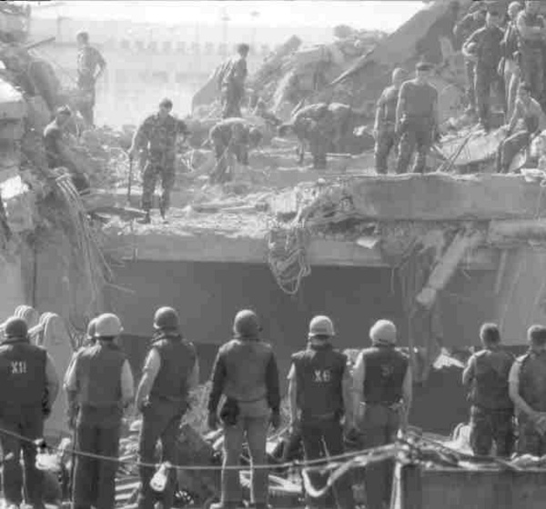 Rescue and clean-up crews search for casualties following the barracks bombing in Beirut on October 23, 1983.