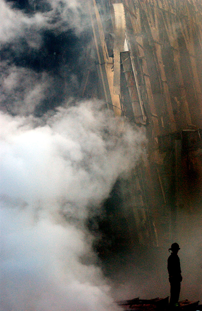 Firefighters continue to battle fires amid the wreckage of the WTC, 13 Sept 2001