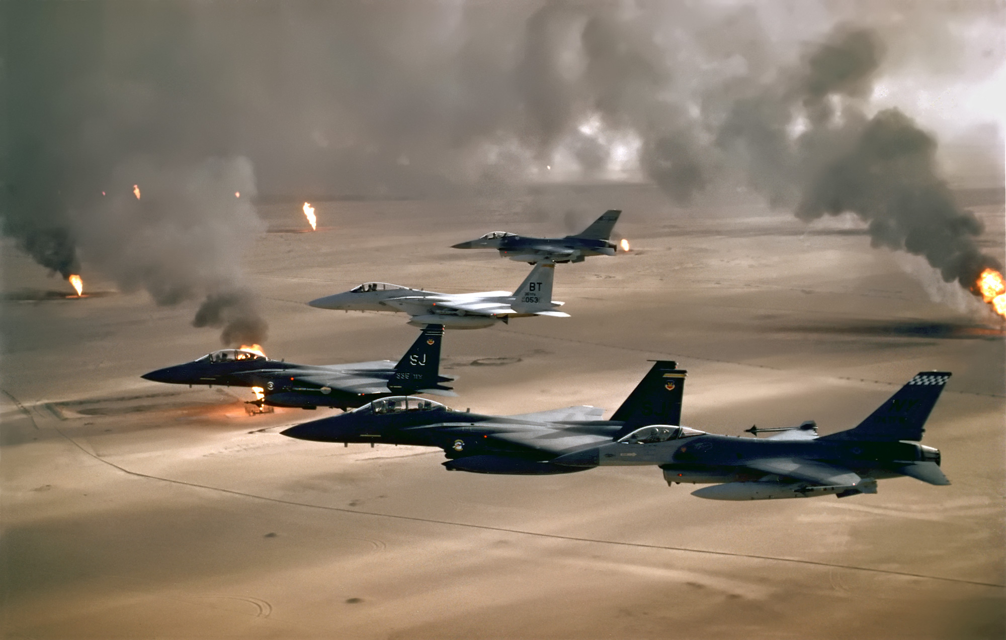 USAF aircraft of the 4th Fighter Wing fly over Kuwaiti oil fires